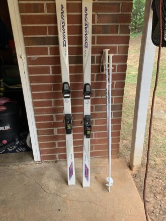 Two pair of snow skis. One men Rossignol and women Dynastar