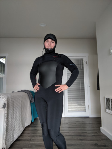 Drylock wetsuit with hood. Only used 3 times.  Brand new conditi