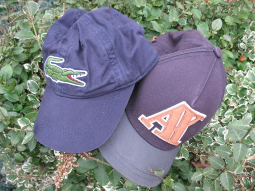 Armani Exchange and Lacoste hats