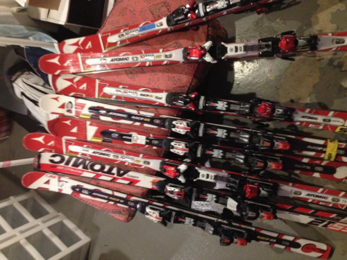 7 pairs of Atomic double deck race skis for sale, w/ bindings
